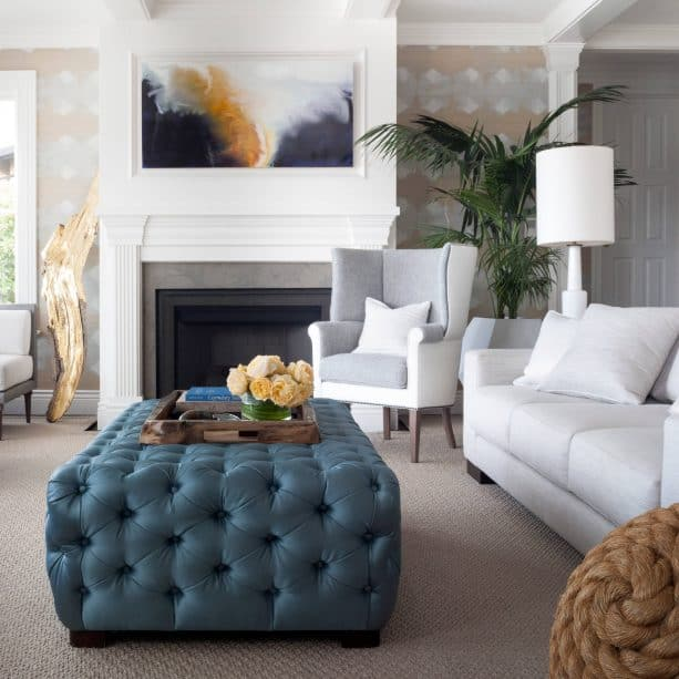 grey and blue transitional living room with ocean blue rectangle tufted ottoman