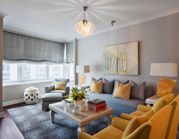 grey and yellow living room with mustard chairs and pillows
