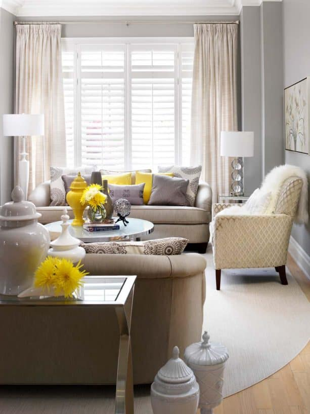 grey and yellow living room with yellow chrysanthemums in clear glass vase
