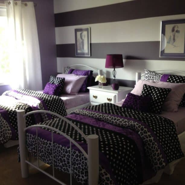 purple and grey bedroom with black accents