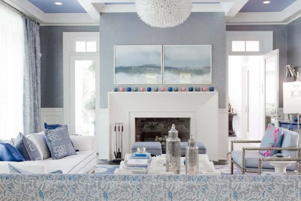 transitional grey and blue living room with cloudy mountain-themed wall artwork