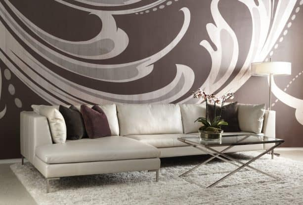 grey and brown living room with a mural pattern on the wall