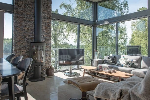 grey and brown living room with large glass windows
