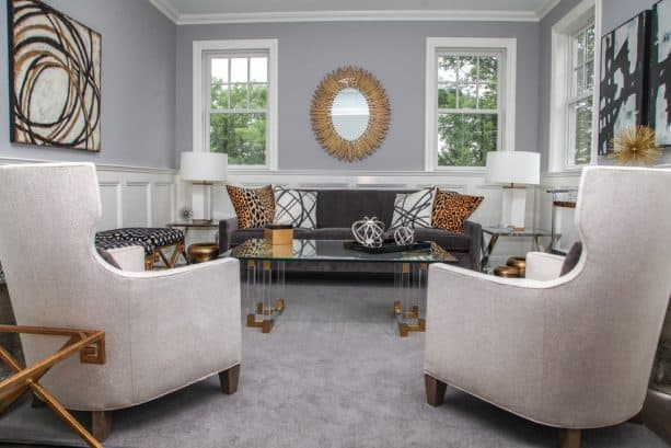 grey and brown living room with leopard print pillows