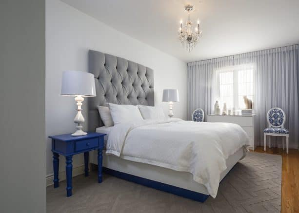 grey bedroom with blue table