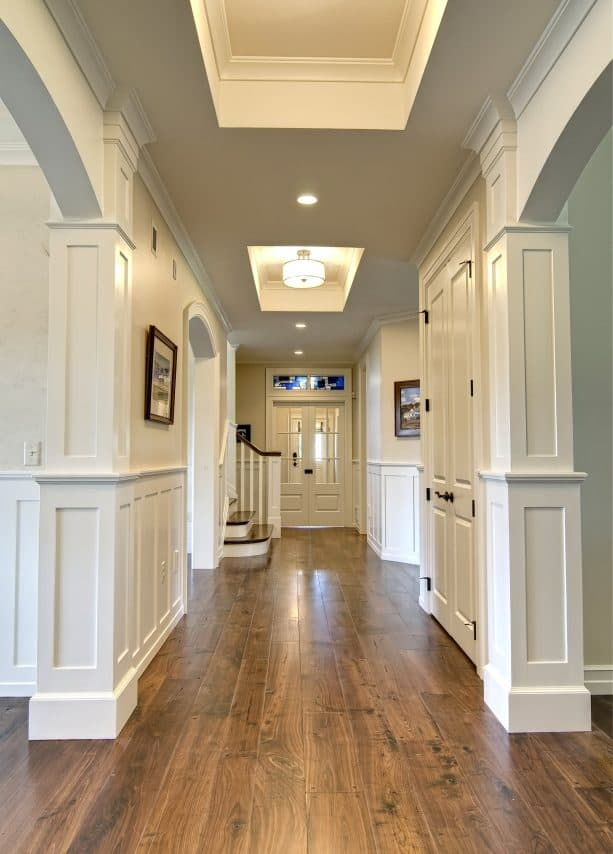 a hallway with warm white paint