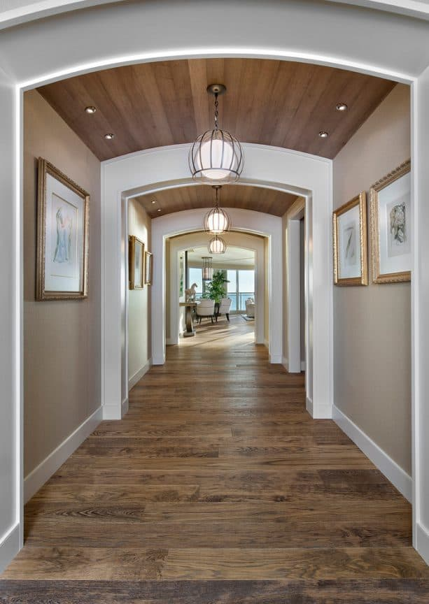 beige hallway with archways feature