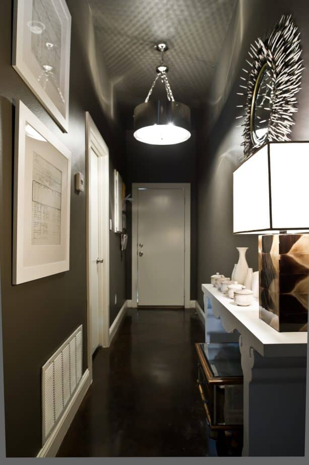 black hallway with white trim