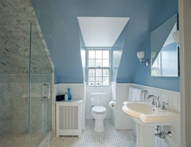 grey and white bathroom with a blue wall