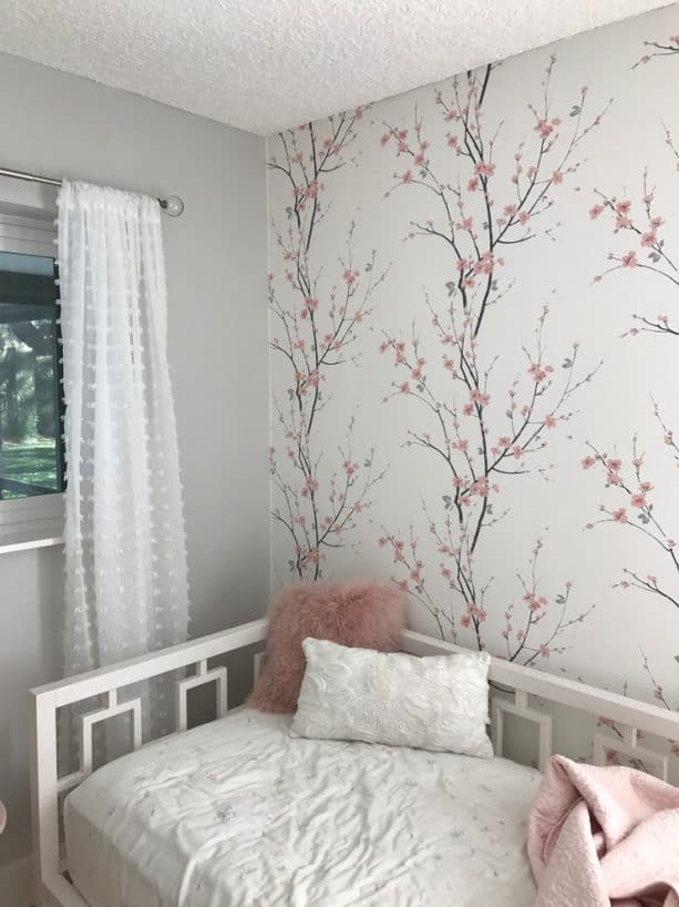 pink and grey bedroom with cherry blossom wallpaper