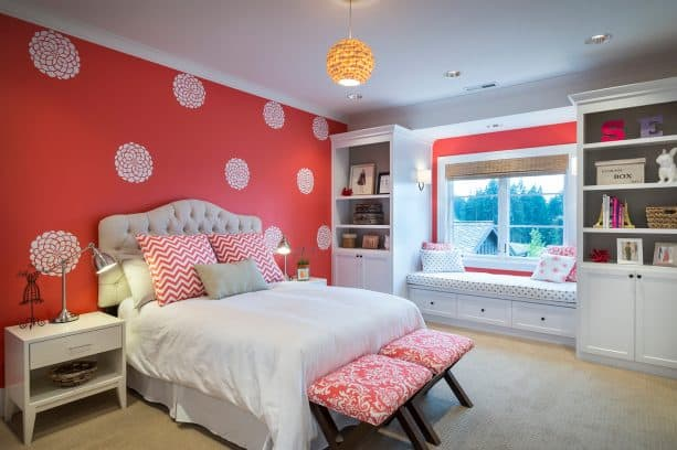 red and grey bedroom with a stenciled red wall