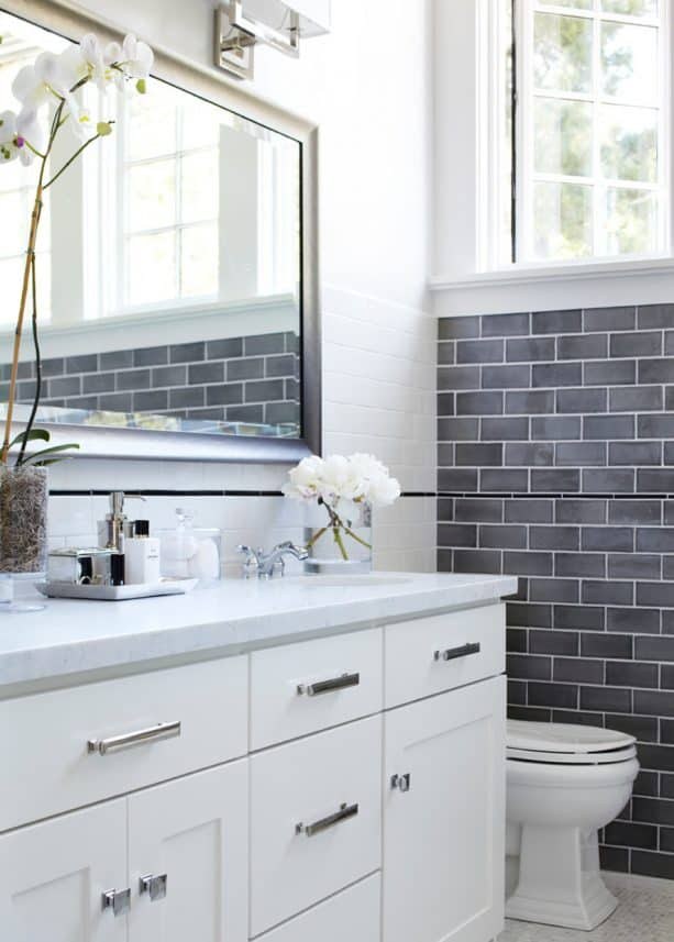 white bathroom with grey subway tile wall