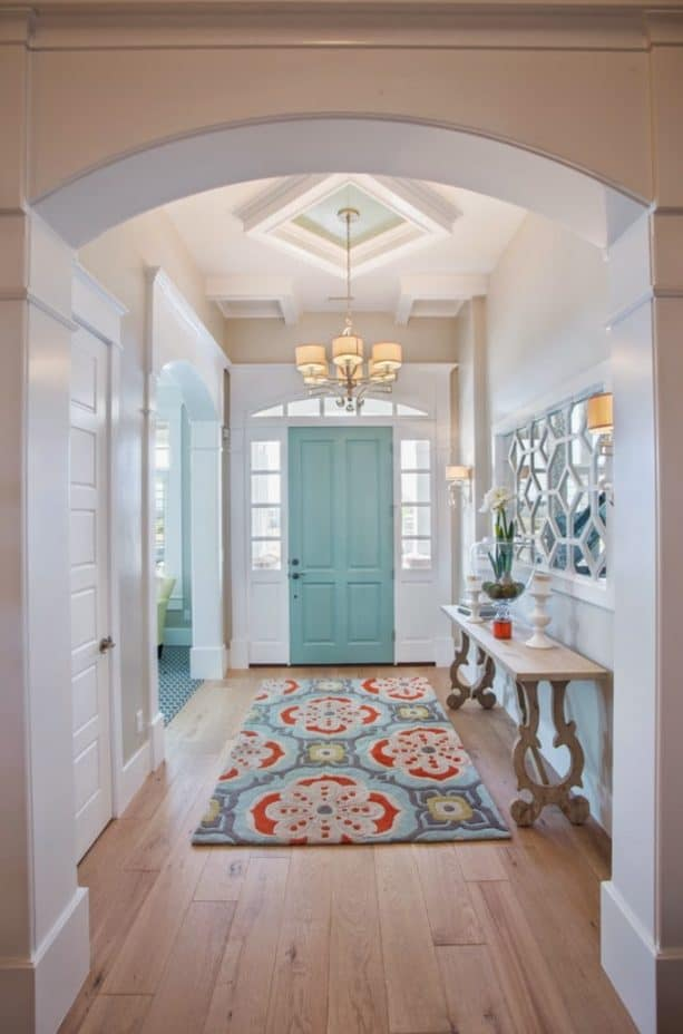 white hallway with blue door