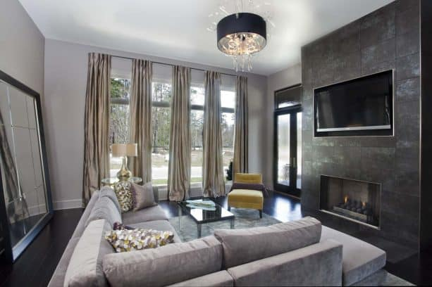 grey living room with mustard chair