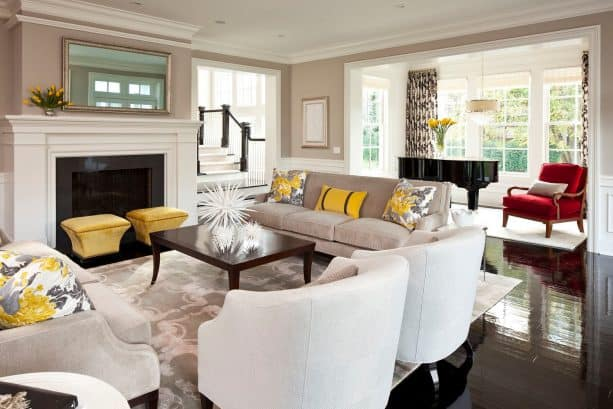 living room with grey, mustard, and white color scheme