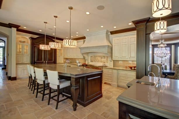 off-white cabinets paired with French style range hood with crown molding