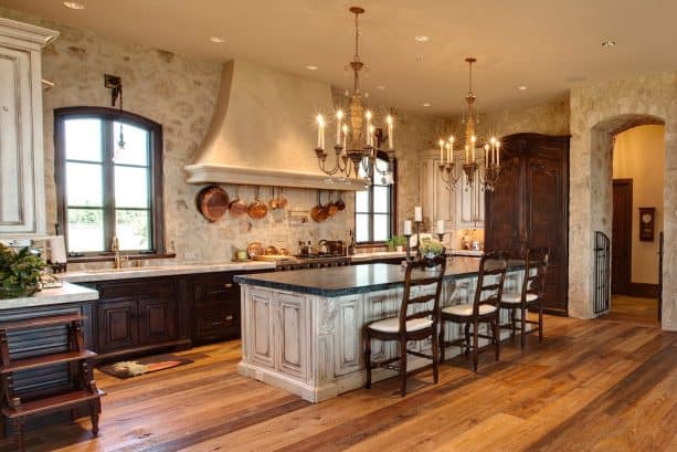 off-white kitchen cabinets paired with a natural stone wall