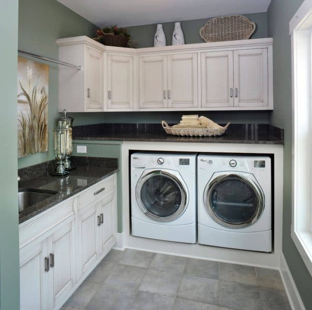 white and sage green laundry room