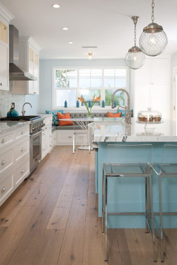 white shaker cabinets paired with a blue island