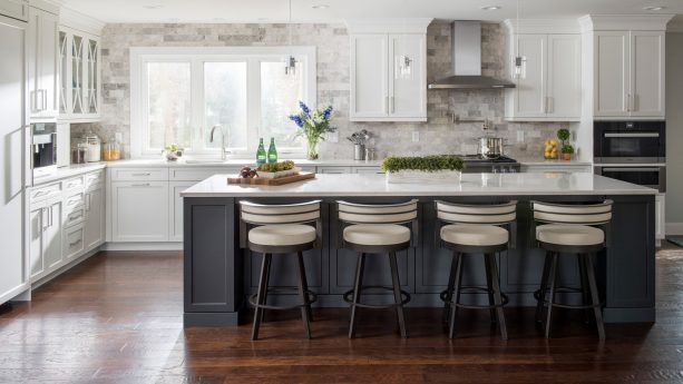 white shaker cabinets paired with charcoal island