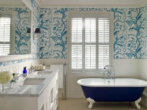 bathroom with navy blue coated clawfoot tub