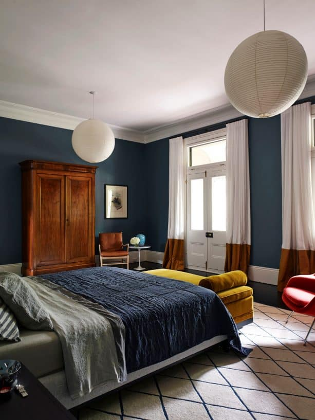 navy blue-dominated bedroom with wood cupboard