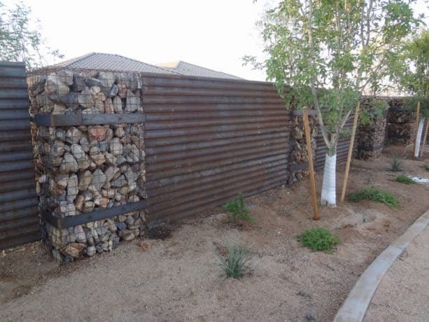 corrugated metal and gabion wall combination for fencing