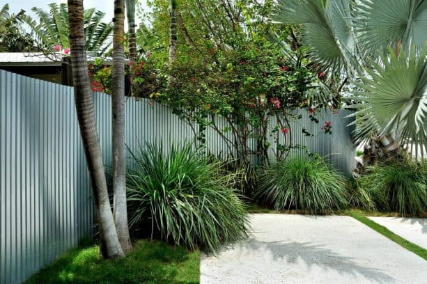 the use of corrugated metal for backyard fence
