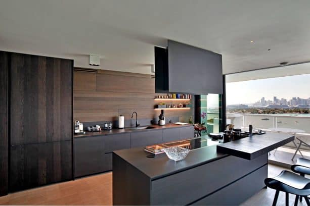 black contemporary kitchen cabinets with dark wood backsplash