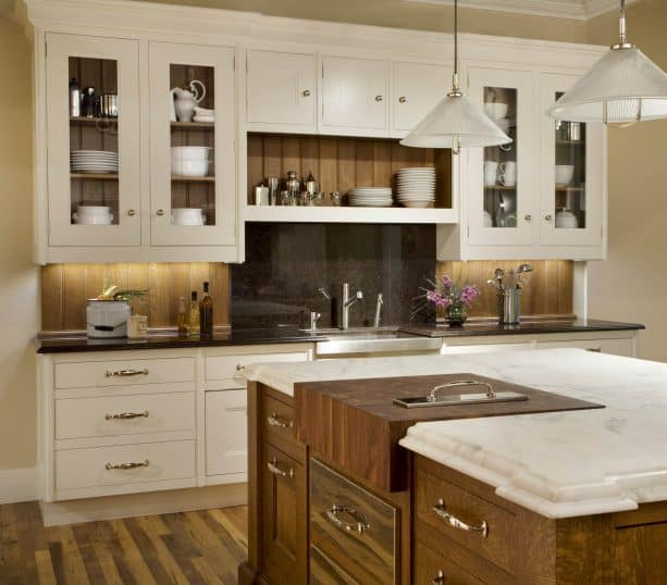 darker wood backsplash paired with cream kitchen cabinets