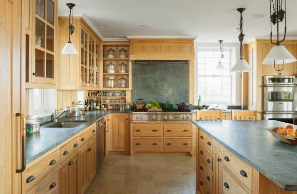 wood kitchen backsplash with the same color with the cabinets