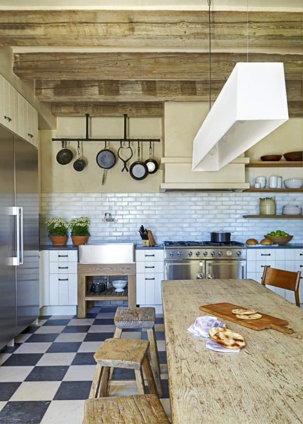 limestone and granite tile floor in a farmhouse kitchen interior