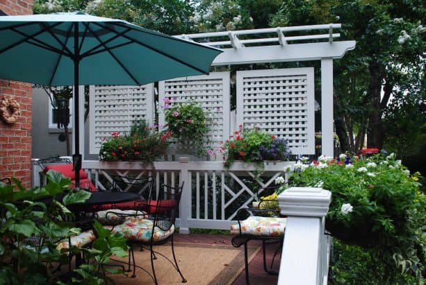eclectic deck with hanging privacy screens