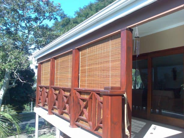 the use of roll-up bamboo blinds outside glass door and windows