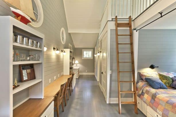 beach-style kids room with grey paneled wall and custom-stained white oak