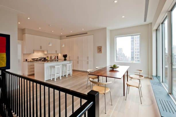open contemporary dining room with silvery grey walls and matte-finished white oak wood floor