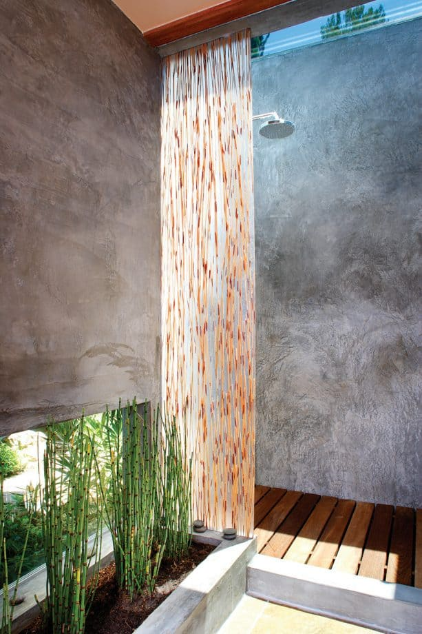 outdoor modern Asian bathroom with cement plaster wall and deck-like wood floor