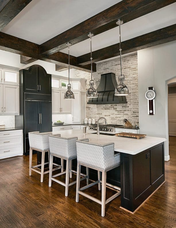 transitional kitchen with neutral grey wall and plywood floor with oak finish
