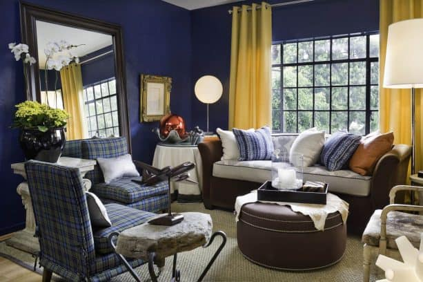 bright yellow curtains on vibrant and a bit dark blue walls in an eclectic living room