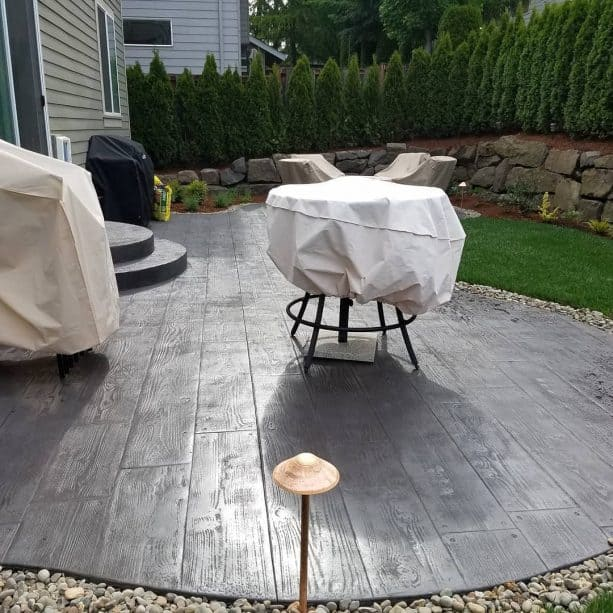 a beautiful patio with dark concrete wood floor