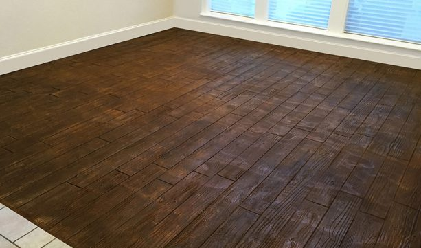 an example of stamped concrete wood floor in basement area