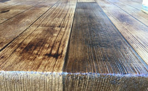 concrete floor gets a wooden look by applying broom finish method