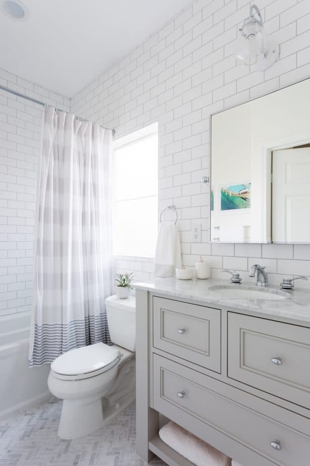 serene transitional bathroom with standard white subway tile and platinum gray grout on the walls