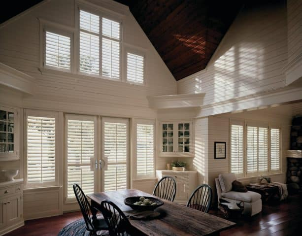 white-painted faux wood plantation shutters on white French doors
