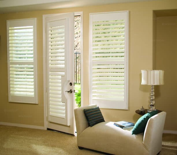 white plantation shutters covering a single French door