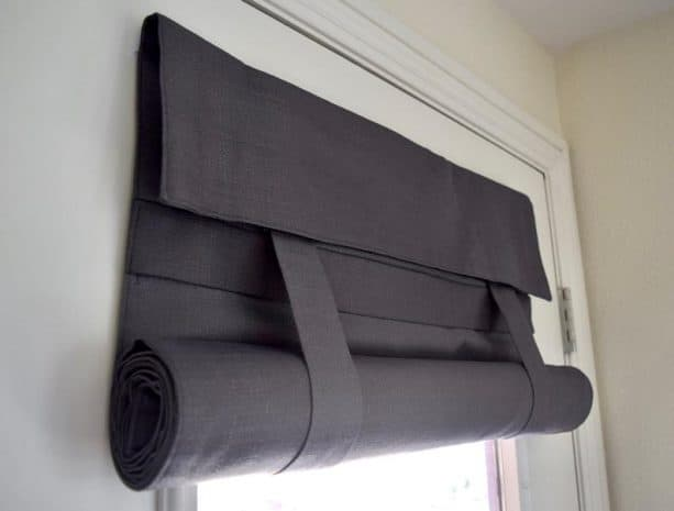 dark grey roll up curtain with straps for half glass door