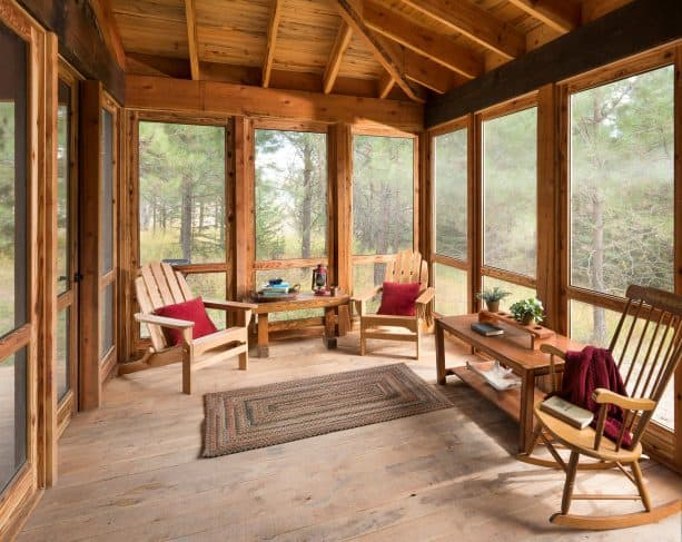 a rustic screened porch with tongue and groove deck for the roof