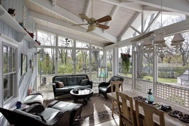 a traditional sunroom with whitewashed tongue and groove roof deck