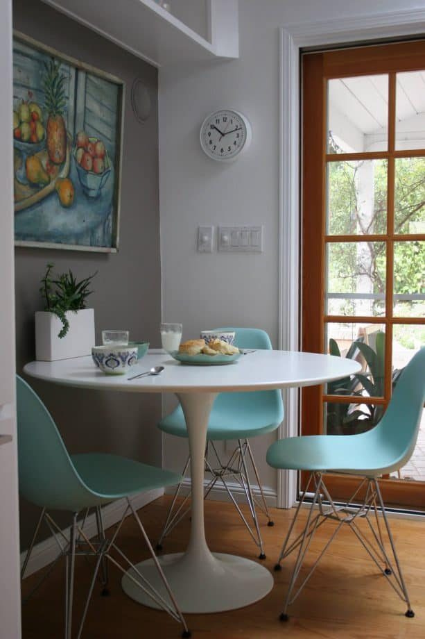 pastel turquoise chairs and grey walls in a transitional dining room