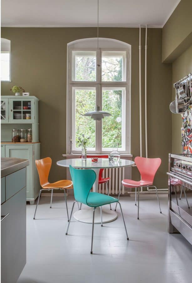 turquoise and tangerine chairs in a contemporary dining room